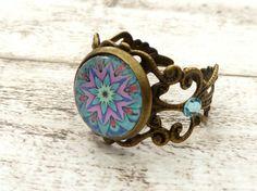 Filigraner Ring mit Mandala Motiv in türkis lila von Schmucktruhe