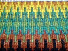 Krokbragd is a weft-faced weave which is effectively double-sided, but with the pattern only on one side... It is threaded on three shafts in a 4-thread repeat draw, so 1-2-3-2-1-2-3-2 and so on. Three treadles are tied up: two are a 2/1 twill, with the third being plain weave. Having a pick of plain weave in every third pick not only helps to create the pattern, it also creates a flat fabric rather than one which will want to curl at the edges, which a pure twill draft will create.