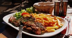 (1)CÉST UNE IMAGE DE STEAK ET LE STEAK-FRITES. (2) what a good way to enjoy paris cafes  with steak and steak fries.(3) This steak is a steak that is served with very salty fries.(4) Jean Morton