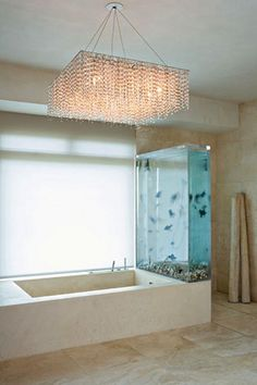 Sweet Fish Tank.....Kanye's bath inclusive of a 250-gallon tank filled with black moor and chocolate Organda goldfish. That's amazing and so is the chandelier!