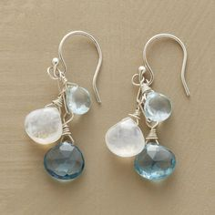 """BLUE MOONLIGHT EARRINGS--Suspended between blue sky and moonlight, Swiss and London blue topaz cascades alongside faceted moonstones beneath sterling silver French wires in these blue topaz and moonstone earrings. Exclusive. Handmade in USA. Approx. 1-1/4""""L."""