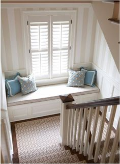 Love the window seat on the stair landing.  Lots of Ikea pieces would make easy work of this.