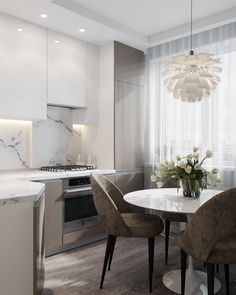We LOVE this contemporary glass kitchen. Use our beautiful RAUVISIO crystal surfaces in your home: Kitchen Room Design, Modern Kitchen Design, Dining Room Design, Home Decor Kitchen, Kitchen Interior, Home Kitchens, Küchen Design, House Design, Round Kitchen