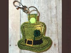 St. Patrick's Day Hat Key Fob  This design sews in the 4x4 hoop, on green vinyl.  Available Formats Include - DST, PES, PEC, HUS, JEF, VIP, VP3, and EXP.  You may make this design as many times as you like, and you may sell your finished item, however, please do not modify, share or resell my original digital design.  Thanks so much and happy stitching!!