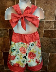 Another new romper in this beautiful fabric!  Size shown 4T Price: $30  Available in sizes 6-12 mo, 12-18mo, 24mo/2t, 3t, 4t, 5t, 6, 7, and 8. — at Heartfelt Homemades.