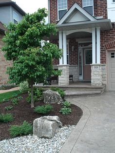Stamped concrete walkway and driveway with simple planting