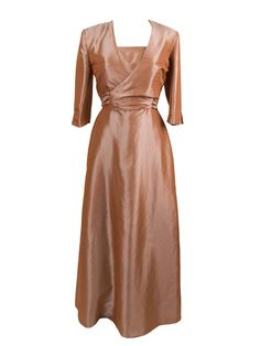 Landa Designs M775 is a satin faced taffeta gown that includes an elbow length bolero jacket. Wrap tie band on the waist. Strapless A-Line long dress with beaded trim at the natural waist.
