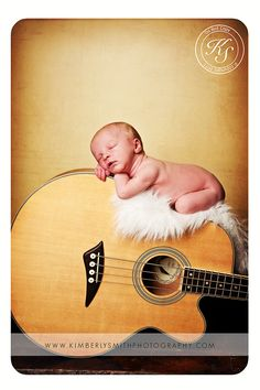 Newborn pose on guitar....capture baby with a sentimental item....This will be my future grand baby lol