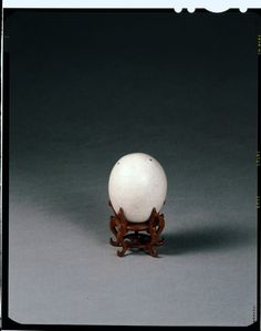 Stoneware model egg with thick, opaque white glaze with fine, even crackle. There are three small spur marks at one end. Chinese Republic, 1912-1949