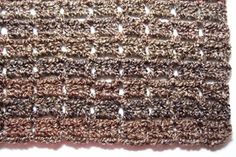 The first row of an afghan with homespun or bouclé or other knobby style yarn can be frustrating. This afghan does not require finding chain stitches, even for the first row. Every side has a loop finish.