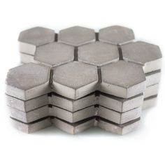 Concrete Coasters.  Don't pay $48 for these... buy inexpensively at home improvement or tile store, felt the back yourself, and you're good to go!