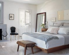 I like the simplicity of the bed and linens yet the elegance the room with the chair and mirror