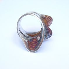 """aranajewelry: Triple Oyster Ring. """"Originally inspired by topographical maps, but the end result does resemble an oyster. No laser cutting was used in its construction.For the original piece, each layer of the oyster was cut from a sheet of metal then filed to shape then welded together. All reproductions are made through lost wax process. The colors are produced through oxidation and always turn out different. """""""