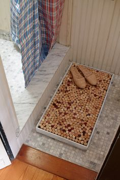 If you're tired of regular bath mats soaking through to the floor (and feeling nasty all day), you can always make your own out of wine corks—not only are they cheap (or free), but their entire purpose in life is to get splashed with liquid and dry off again. - oddee.com