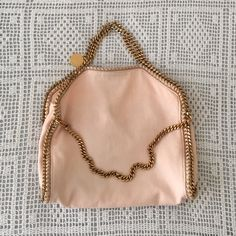 PME pick🌿V🌿Stella McCartney pink linen Falabella Host & PM Editor pick, exquisite & sold out. Bought at Luisa via Roma in Florence spring 14. Pink linen w gold chains. Satchel & shoulder bag when folded. Some variations in color. A few smudges in inner corners of whipstitch & faint blue denim dye on the back (pic 2) that was mostly dry cleaned out by trusted (& expensive) UES cleaner Art Bag. Can add separate listing with more pics on request. Follow me on Instagram @jessinboots for sneak…