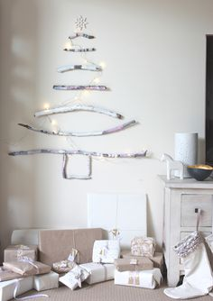 apartment living and decoration - Paint-Stick Christmas Tree via The Happy Home Driftwood Christmas Tree, Stick Christmas Tree, Noel Christmas, Xmas Tree, Christmas And New Year, All Things Christmas, Winter Christmas, Christmas Crafts, Christmas Decorations