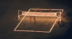 String lights on a volleyball net... The perfect way to celebrate the Fourth of July!