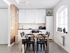 Scandinavian kitchen, simple but beautiful. Interesting wood panel wall.