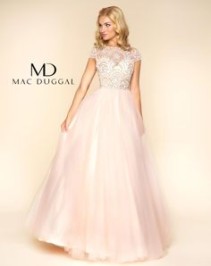 Let your personality shine through in this brilliant ball gown. Watch as heads turn when you make your awe-inspiring grand entrance. In two soft colors of blush and powder blue, this dress will illuminate your night with a high collar neckline and sheer bodice detailed with incredible embellishments.