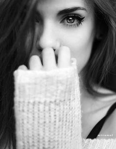 Esta pensando em algo bom ou em alguém carinhosamente. Ou só reagindo à algo que ela gostou.