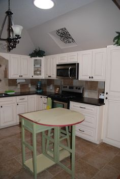 Garage apartment:  kitchen includes 2 lazy Suzan corner turntable cabinets, gas stove, built in microwave, Stainless steel appliances, Frig has an icemaker and water filter.  Deep stainless steel sinks, dish washer, garbage disposal. tile floor, walk in pantry, Solor tube in ceiling for extra light.