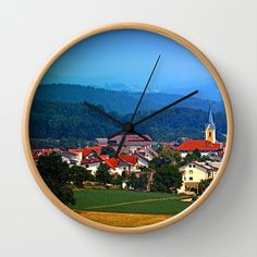 Village skyline on a summer afternoon Wall Clock