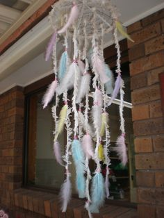 This lovely hanging mobile would be perfect for a baby nursery...in pastel colours of pink, blue, lemon and mauve. Available at https://www.etsy.com/au/listing/248912582/dreamcatcher-dream-catcher-hanging?ref=shop_home_active_4