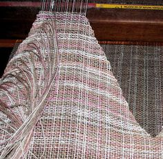 To weave a shaped neck or arm hole, cut the warp thread and weave it in the next row as weft.