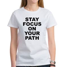 Women's light color white t-shirt with Stay Focus On Your Path theme. You will be tested on a mental, physical and spiritual level, temptation and distractions will come; unexpected events in life, with family, etc; stay focus. Available for only $21.99. Go to the link to purchase the product and to see other options - http://www.cafepress.com/stsfoyp