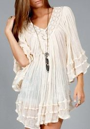 Shopbellastyle.com...features crochet detailing at the neckline with a swing style shape, Dolman sleeves and ribbon detailing. Looks great loose or belted $40