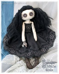 OOAK, Vegan, Gothic, Cloth Art Doll With Button Eyes 'The Keeper' £55.00 - This cute and creepy, little button eyed Goth girl measures approximately 10 inches from head to toe. The Keeper is dressed in black cotton and lace. Her hair is needle felted in place and decorated with ivory and black ribbon. Her face and tattoos are hand drawn in artist pencils and ink. She carries a bunch of silver keys which are permanently fixed to her hand.