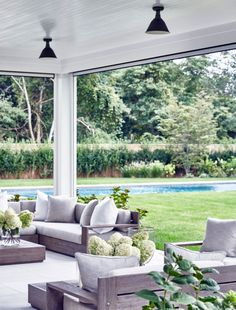 Like the retractable screens for this outdoor area. Great idea for our place! An inspiring beach house in the Hamptons by Chango and Co