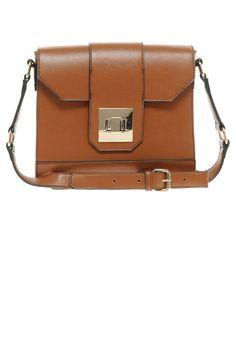 Oasis Square Lock Cross-Body Bag, $57; asos.com   - ELLE.com