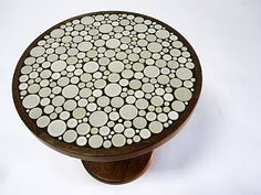 """dimensions: 20"""" H x 19"""" DIA ( base - 12"""" DIA) - This is beautiful round walnut and tile side table. It was designed by Jane and Gordon Martz for Marshall studios circa 1960's. It features a solid walnut base and pole along with small inset ceramic tiles into the top surface."""