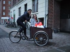 """The best way to get around in Copenhagen is by bike! It's even nicer to get driven around in the box part of a """"Christiania bike"""" while someone else does the hard work. :)"""