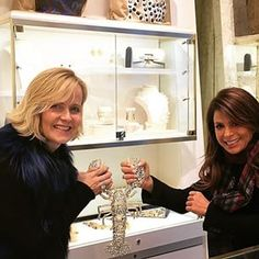 Kara and Paula Abdul make a wishbone out of Lola the Lobster when Paula visited the Kara Ross boutique in New York City.