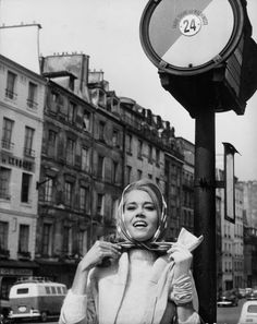 At Paris, Jane Fonda demonstrates the single-gloved scarf-tying technique, a very difficult French move to master, 1963