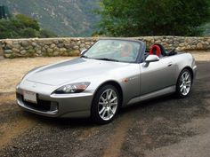 Honda S2000. The classic little sports car. No frills, droptop, rear wheel drive and a joy to push to the limit.