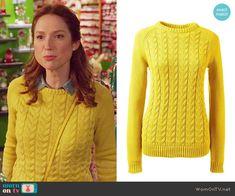 Kimmy's yellow cable knit sweater on Unbreakable Kimmy Schmidt.  Outfit Details: https://wornontv.net/57055/ #UnbreakableKimmySchmidt