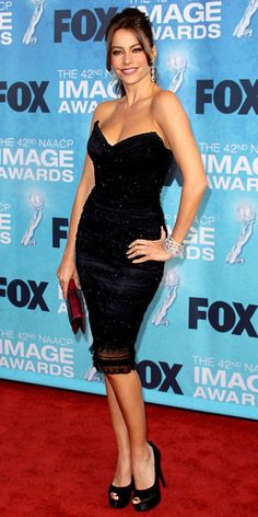 Sofia Vergara in a strapless Dolce & Gabbana LBD paired with a Judith Leiber clutch, satin Stuart Weitzman peep-toes, an Emsaru cuff and Sutra diamond earrings at the NAACP Image Awards.
