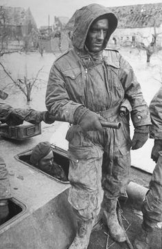 A bone-weary Canadian soldier stands atop a stalled tank amid flooding in the Netherlands, 1945. Read more: 'Fury' in the Real World: Photos of Tank Warfare in World War II | LIFE.com http://life.time.com/history/fury-reality-of-tank-warfare-wwii-photos/#ixzz3HHPSdY34