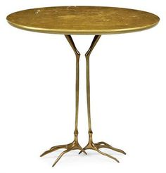 A TRACCIA OCCASIONAL TABLE   BY MERET OPPENHEIM, DESIGNED 1939, EXECUTED CIRCA 1970   For Simon International, giltwood, cast bronze pedestal   25½ in. (65 cm.) high; 26½ in. (67 cm.) wide; 20¾ in. (53 cm.) deep  gbp2750wbp against a pae of 8-12