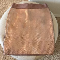 Bebe bronze metallic sequin bodycon mini skirt Bebe bronze metallic sequined mini skirt. Bodycon fit with lots of stretch. Size small. Some minor snags and pulled sequins, otherwise in good condition. bebe Skirts Mini