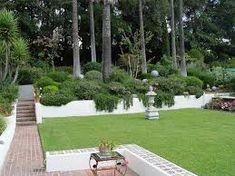 Plant several ground cover plants on the front yard slope? Backyard Slope Backyard Landscaping Maureen Gilmer Morongo Valley, CA Sloped Backyard Landscaping, Sloped Yard, Landscaping With Rocks, Modern Landscaping, Landscaping Tips, Sloping Backyard, Backyard Ideas, Garden Ideas, Backyard Decorations