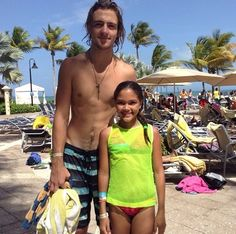Puerto Rico, he looks like a giant next to her. Lol