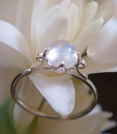Lotus ring with blue rainbow moonstone ~$175