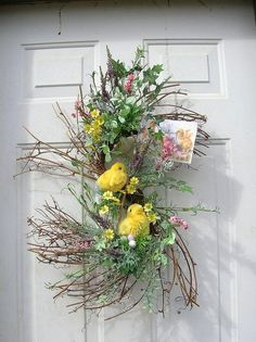 Easter or springtime door spray with flowers & chicks #wreath | by sandys4899florals @ Etsy