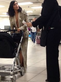 Gown and out: Kim Kardashian was spotted at Los Angeles International Airport on Sunday night, wearing the same Jean Paul Gaultier gown she donned at the Grammy Awards earlier in the evening