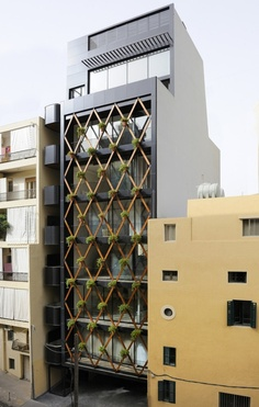 PATTERN: Showing consistency with colors and/or lines. Often times repeated along an x-y coordinate system. The diamond shaped exterior structure provides a pattern to the simple facade. Architecture Cool, Contemporary Architecture, Installation Architecture, Chinese Architecture, Design Exterior, Facade Design, Green Facade, Vertical Garden Diy, Vertical Gardens