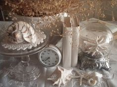 lovely vignette shells , clear glass and shades of white
